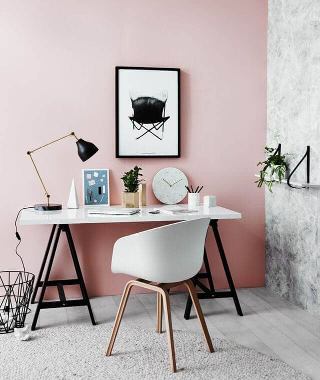A Light Pink Wall Gives Depth To A High Contrast Office