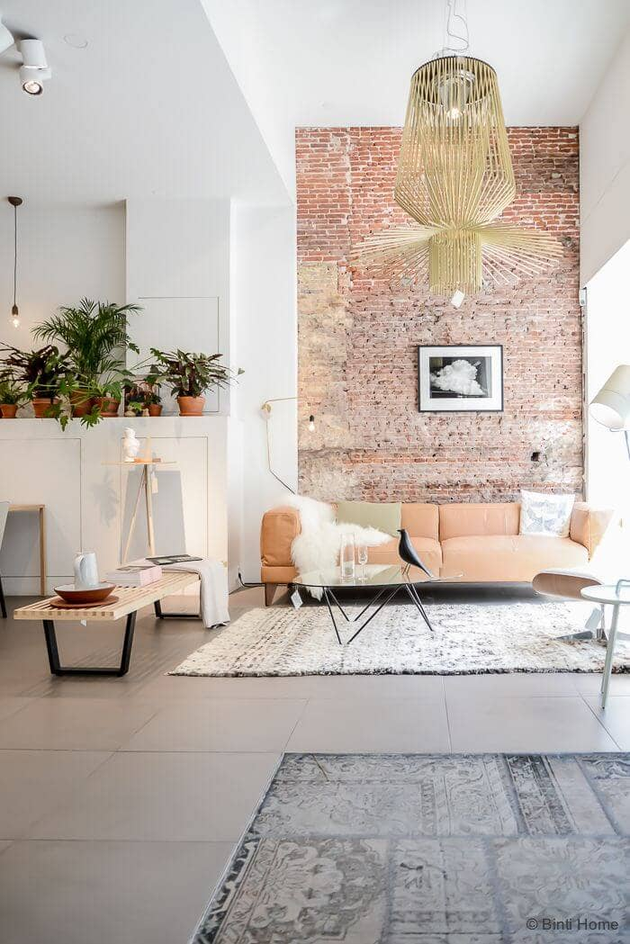 A Salmon Sofa Makes Weathered Brick Look Classy