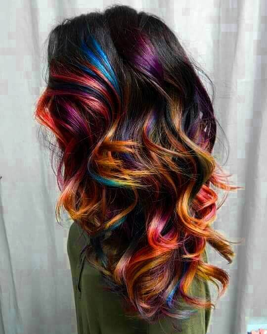Vibrant colors look awesome in dark hair. This style is so unique and eye-catching!