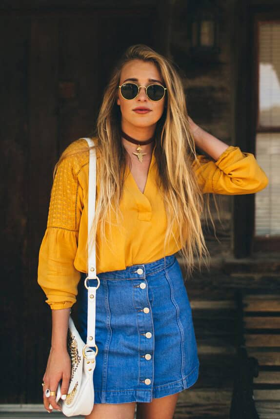 04c298f665 Source: hustleandhalcyon.com. This yellow blouse matched with a  high-waisted, button-up denim skirt ...