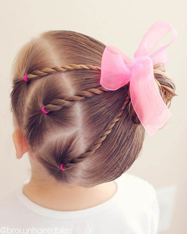 The Pink Bowed Ballerina Twirls
