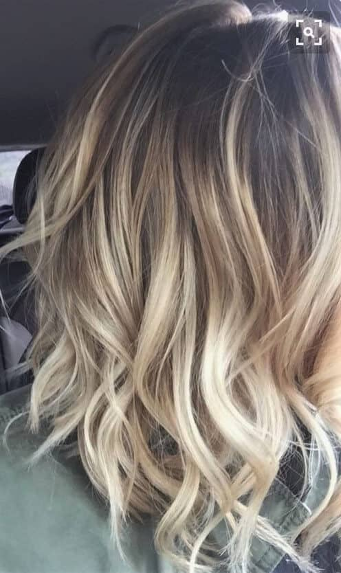Messy, wavy tendrils make for an effortless look