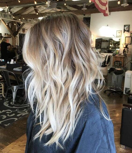 A sexy cool tone bed head channel surfer girl vibes