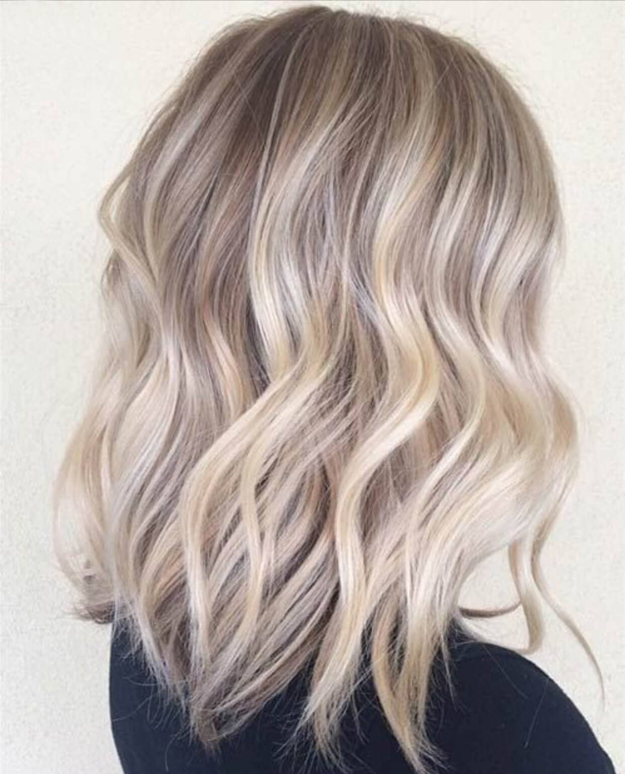 Super ashy highlighted strands blended throughout