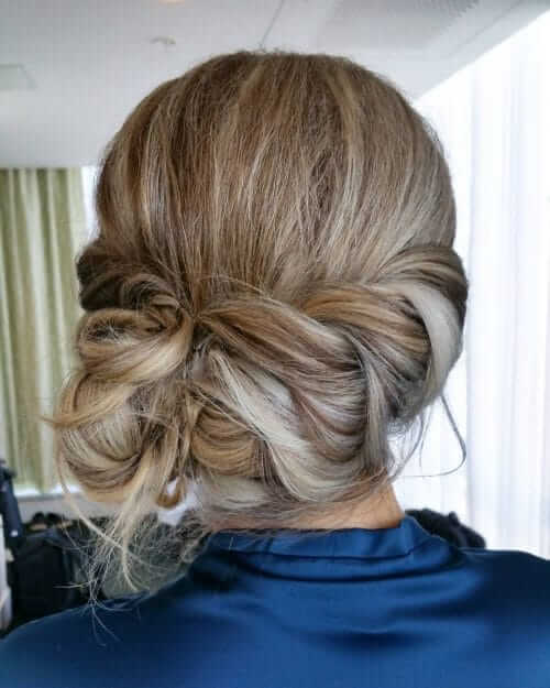Loose Braid Crown With Low Side Chignon