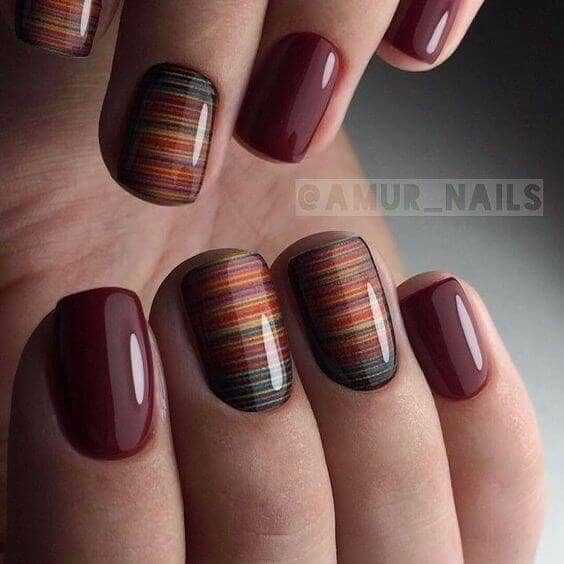 Maroon Manicure with Saturn Rings