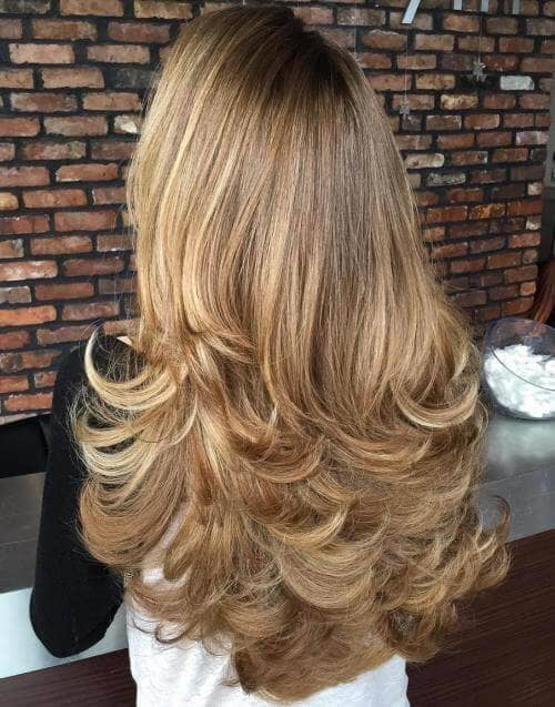 Long Feathered Blonde Layers