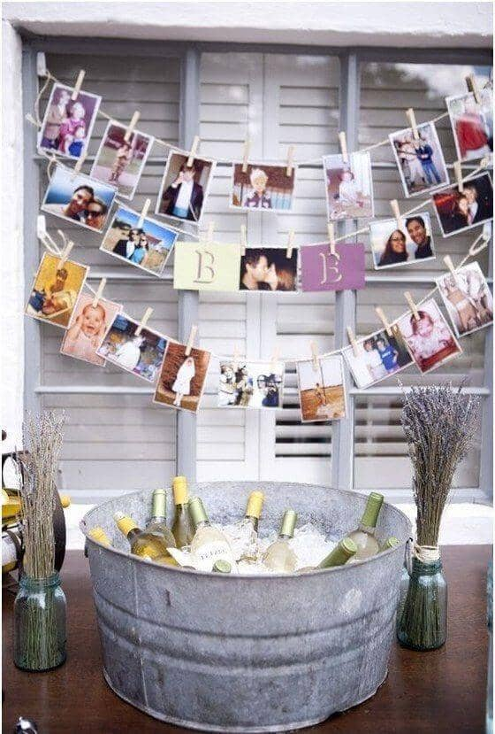 25 amazing diy engagement party decoration ideas for 2018 25 wine bucket with diy clothespin photo display solutioingenieria