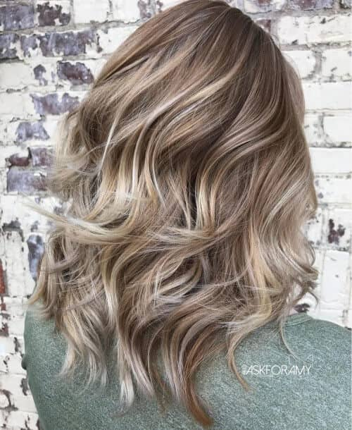 Thick Ashy Blond Layered Hair and Highlights