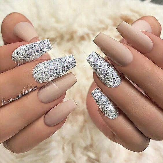 Long Nude Nails with Spectacular Glitter