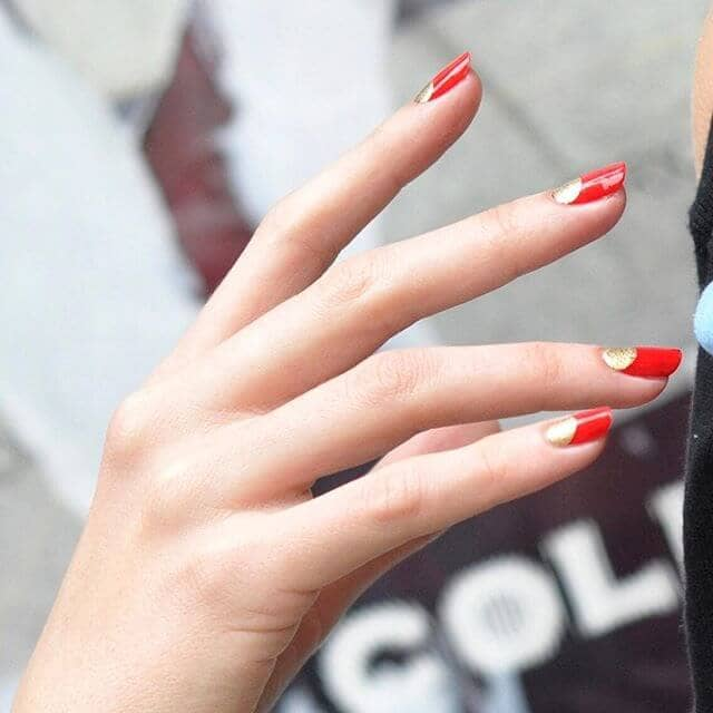 Red Acrylic Nails With A Pop Of Gold