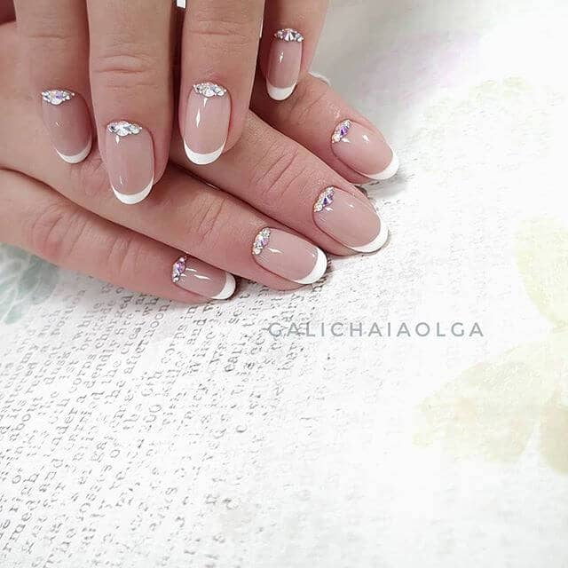 48) Stylish French Tip Manicure with Glitter - 50 Awesome French Tip Nails To Bring Another Dimension To Your Manicure