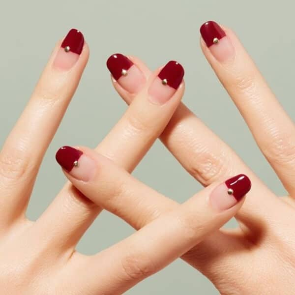49) Minimal Red Nail Design With A Fun Gold Twist - 50 Creative Red Acrylic Nail Designs To Inspire You