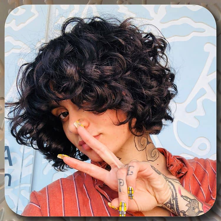 Short And Natural Curls With Bangs