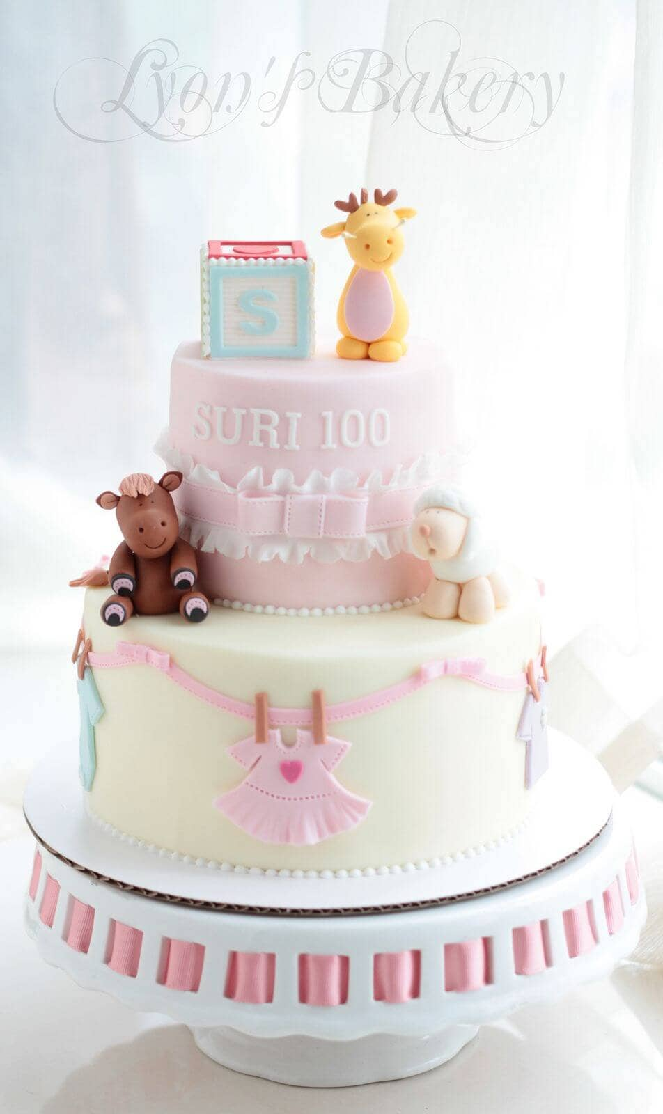 Three Animals Adorn this Baby Girl Cake