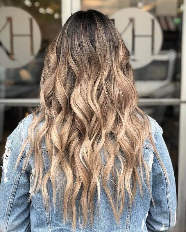 Tight Naturally Golden Wavy Locks