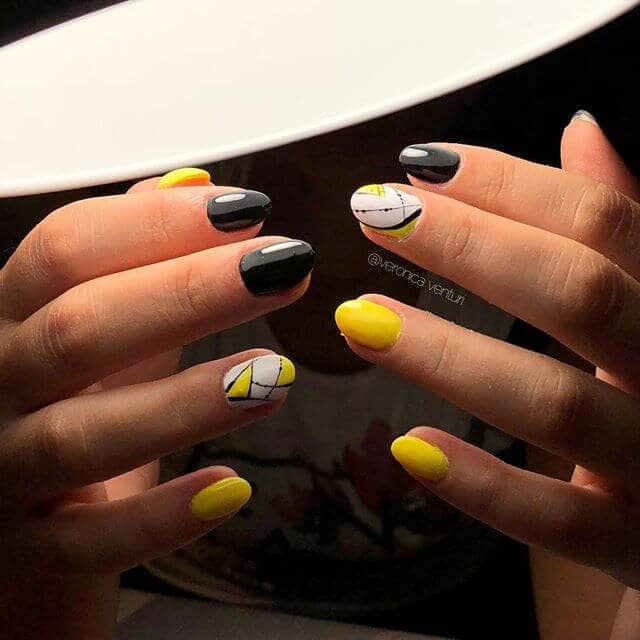Black and Yellow Oval Geometric Nails