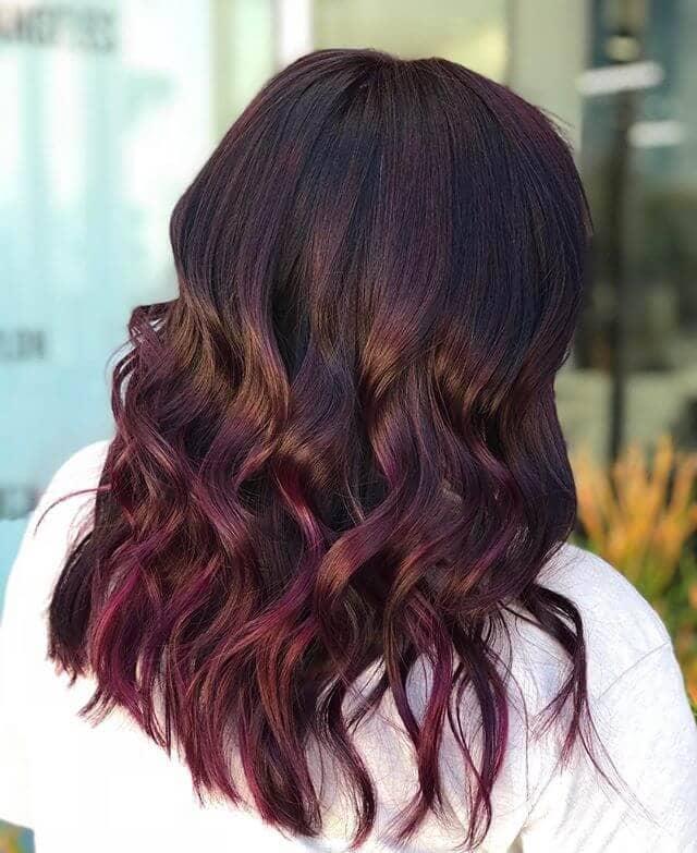 Voluminous Verticle Curls Bathed in Burgundy