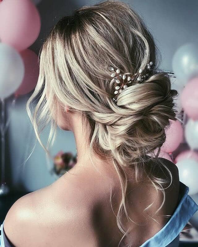Wavy Pieces Tucked Into Low Cute Bun