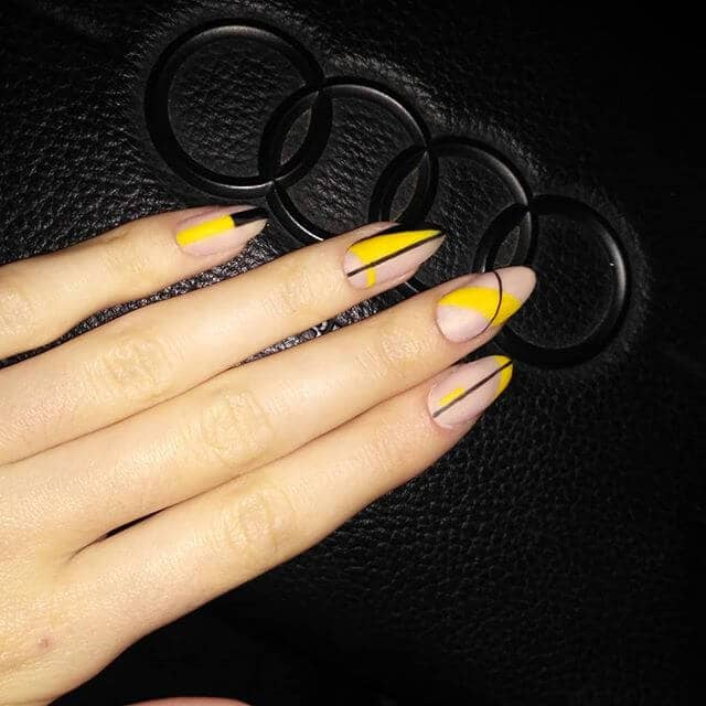 Bold Black and Yellow Almond Nails