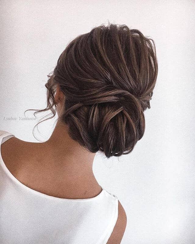 Low Structured Bun With Face-Framing Curls