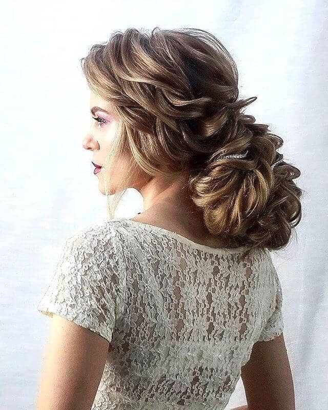 Voluminous Low Bun Woven With Braids