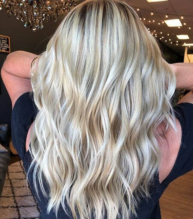 Icy Blonde Streaks with Natural Wavy Layers