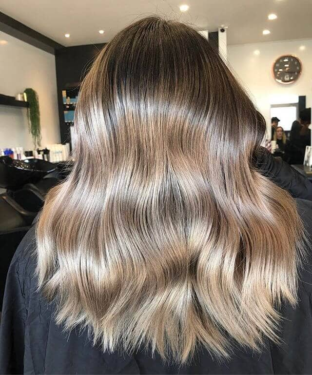 Shiny All-Over Highlights for Brown Hair