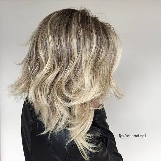 Messy and Layered Asymmetrical Long Bob