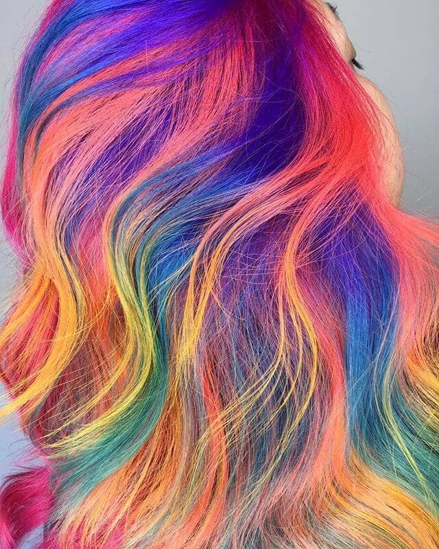 Vibrant Rainbow Streaks in Long Soft Curls