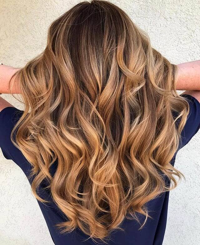 Cute Strawberry Blonde Waves in Brunette Hair