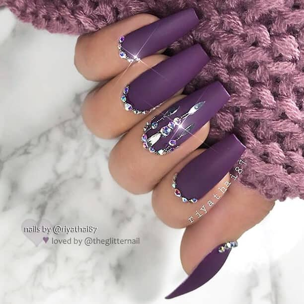 Purple Stiletto Nails with Diamonds as Borders