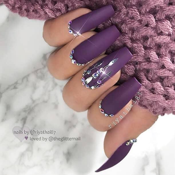 Purple Stiletto Nails with Diamonds as Borders