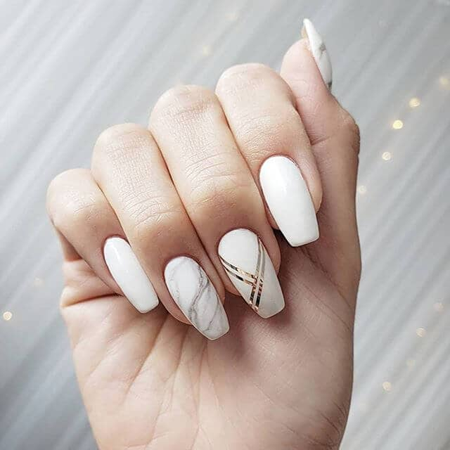 Brilliant White Nails with Marbled and Foil Accents