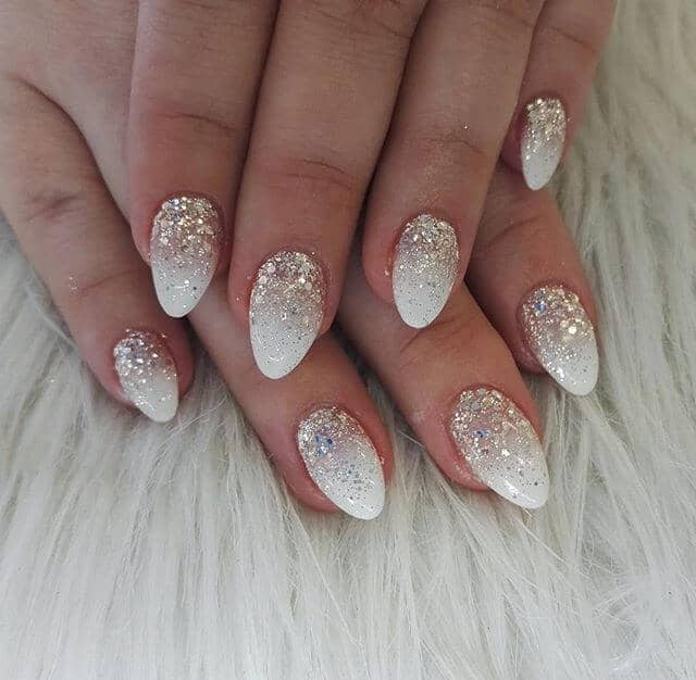 Short Almond Shaped Gold and White Sparkling Nails