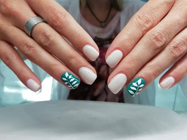 Glossy White Nails with Teal Accent
