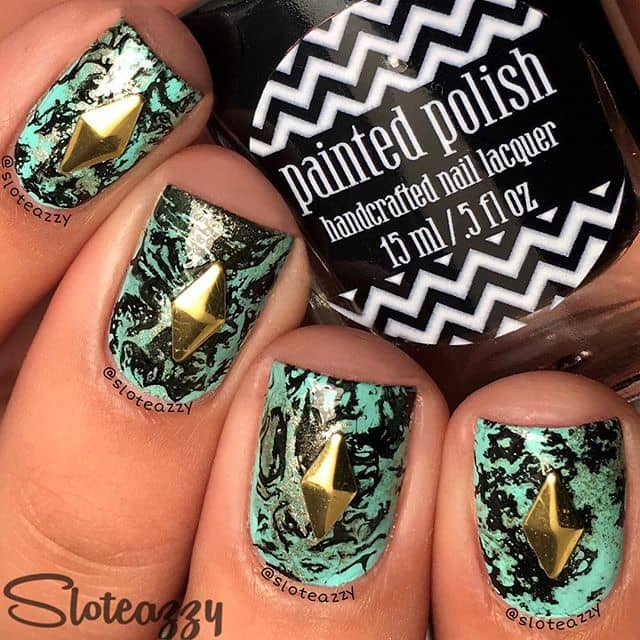 Cool Artsy Black and Mint Marble Nail Design