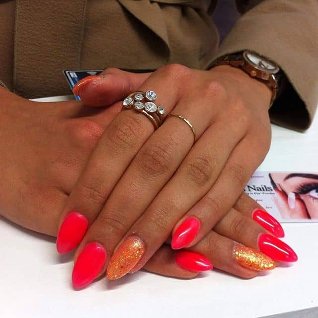 Fiery Red and Orange Nails with Glitter Accen