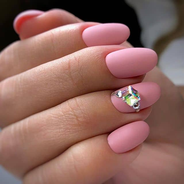 A Matte Pink Mani with a Large Gem