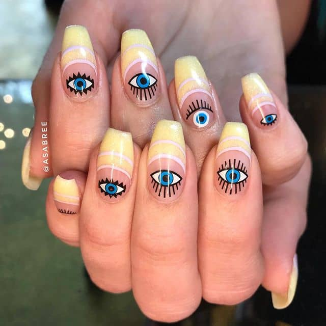 Creative and Unique Eye-Filled Yellow Nails