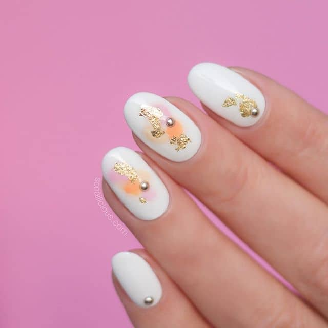 A Unique Foiled Manicure with Sporadic Studs