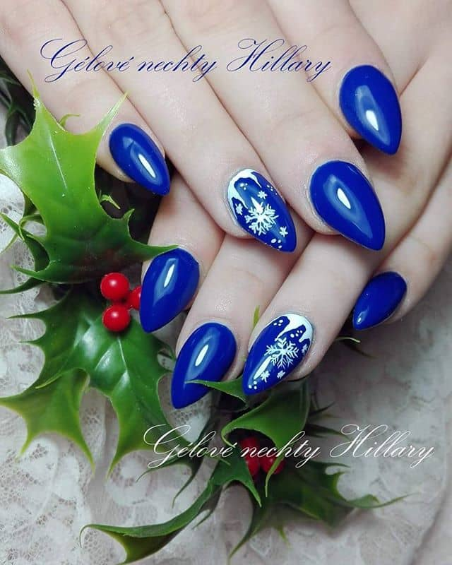 Holiday Blue Nails with Pretty Snowflake Detailing