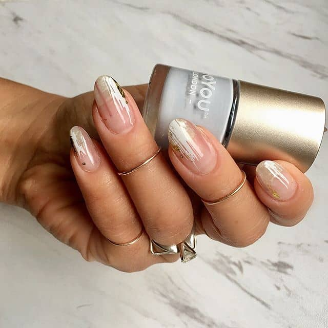 A Chic, Clear Manicure with Subtle Detailing