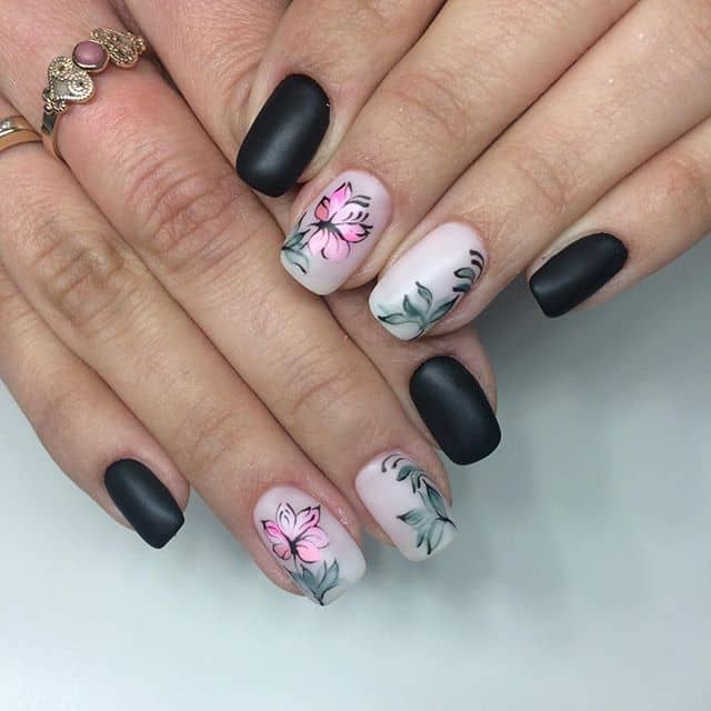 Edgy Matte Black Flower Nail Idea
