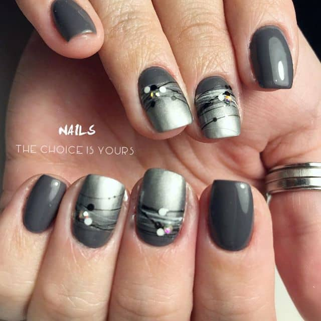 Silver Nail Art with Black and White Line Designs